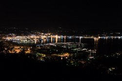 View of the port from the road to Riomaggiore at night, La Spezia, Italy